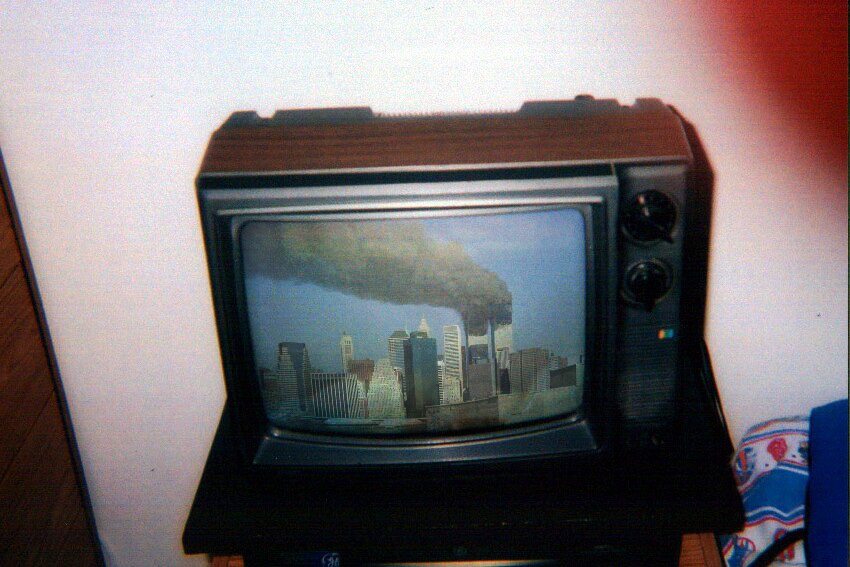 CRT TV showing the Twin Towers in smoke